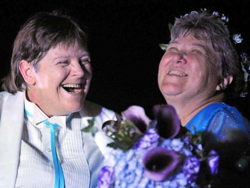 Cheryle Rudd (C) and Kitty Lambert are pronounced legally married at the stroke of midnight, at the brink of Niagara Falls, in Niagara Falls, New York. Thousands of gay and lesbian New Yorkers are getting ready to say