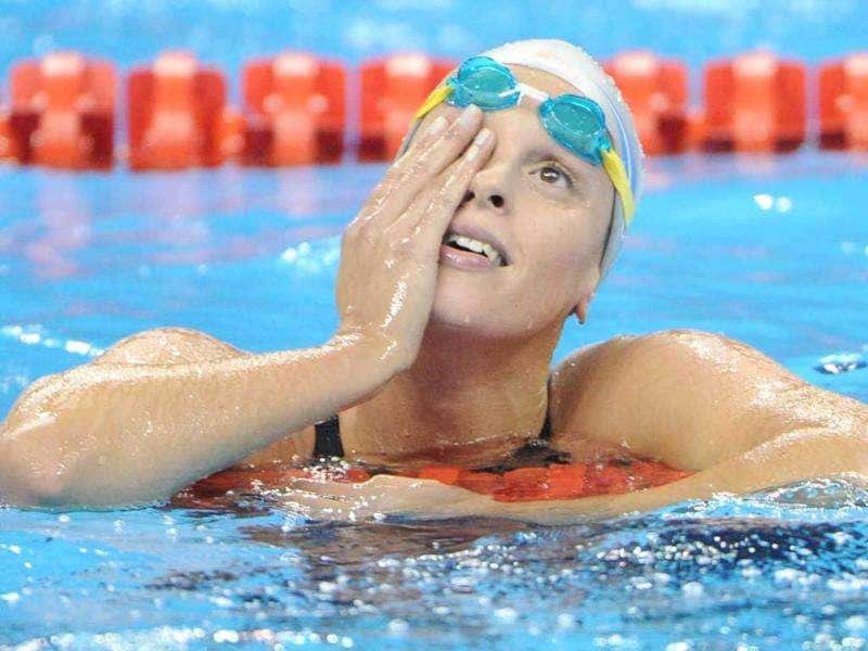 Italy's Federica Pellegrini reacts after she competed in the heats of the women's 400-metre freestyle swimming event in the FINA World Championships at the indoor stadium of the Oriental Sports Center, in Shanghai.
