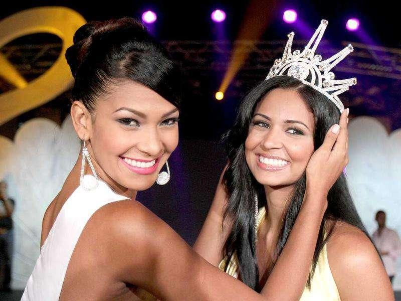 2010 Miss World Next Top Model Venezuelan Luna Ramos (L) crowns her countrywoman Karen Soto after she won the 2011 edition of the competition in Beirut.