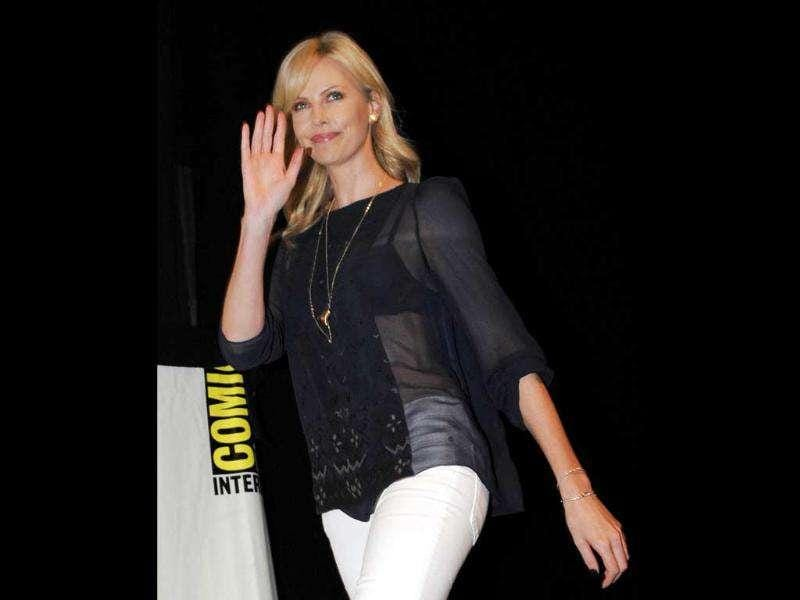 Actress Charlize Theron waves as she arrives for a panel for the movie Snow White And The Huntsman at Comic-Con International 2011 convention in San Diego.