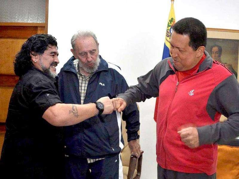 Hand out picture provided by the Miraflores Palace press office shows Venezuelan President Hugo Chavez (R) as he welcomes former soccer star, Argentinean Diego Armando Maradona (L) with Cuban leader Fidel Castro (C) during a meeting in Havana, Cuba. Chavez thanked Maradona for visiting him in Havana where Venezuelan leader receives a medical treatment against cancer.