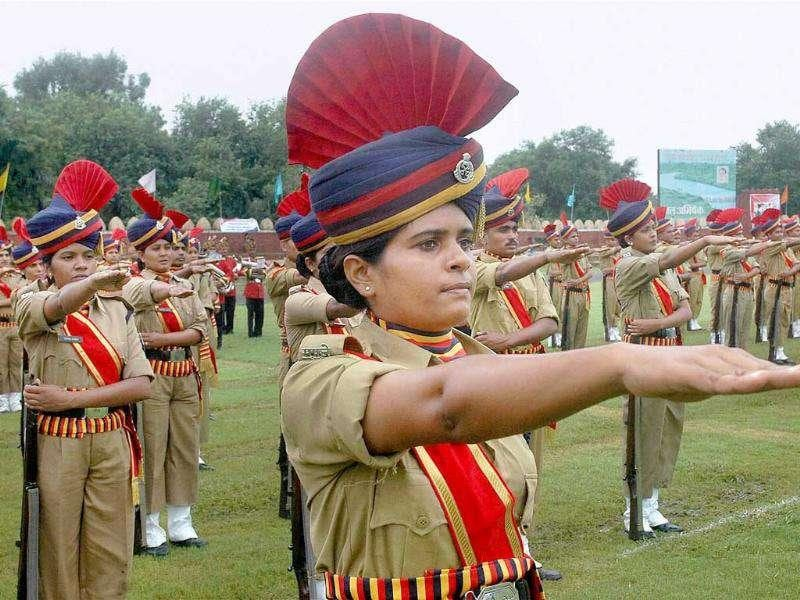 Newly recruited police contingents of Madhya Pradesh jail department take oath to serve nation in a passing out parade after their five month rigorous training during a convocation ceremony at Motilal Nehru Police Stadium in Bhopal.