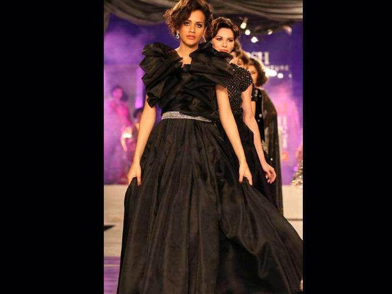 A model poses in an outfit by designer Adarsh Gill at Delhi Couture Week 2011 in New Delhi on Sunday.