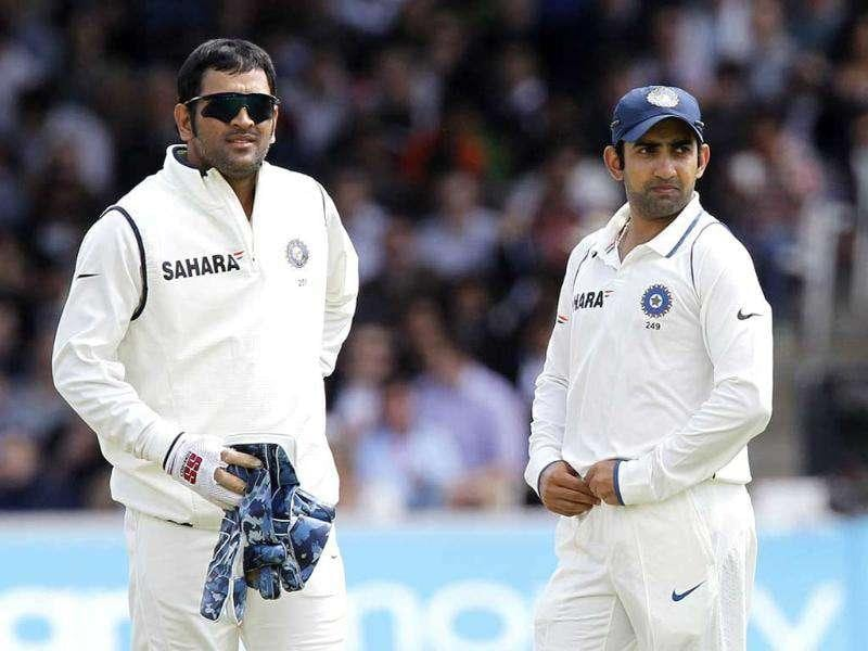 India's captain and wicketkeeper MS Dhoni (L) stands next to Gautam Gambhir during Day 4 of the first Test match against England at Lord's in London.