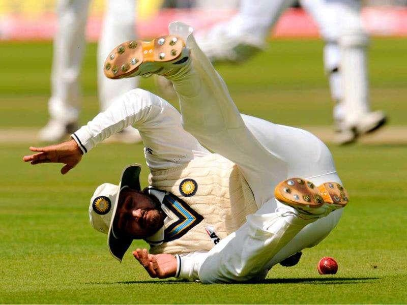 Harbhajan Singh falls on the ground after fielding the ball during Day 4 of the first cricket Test match against England at Lord's in London.
