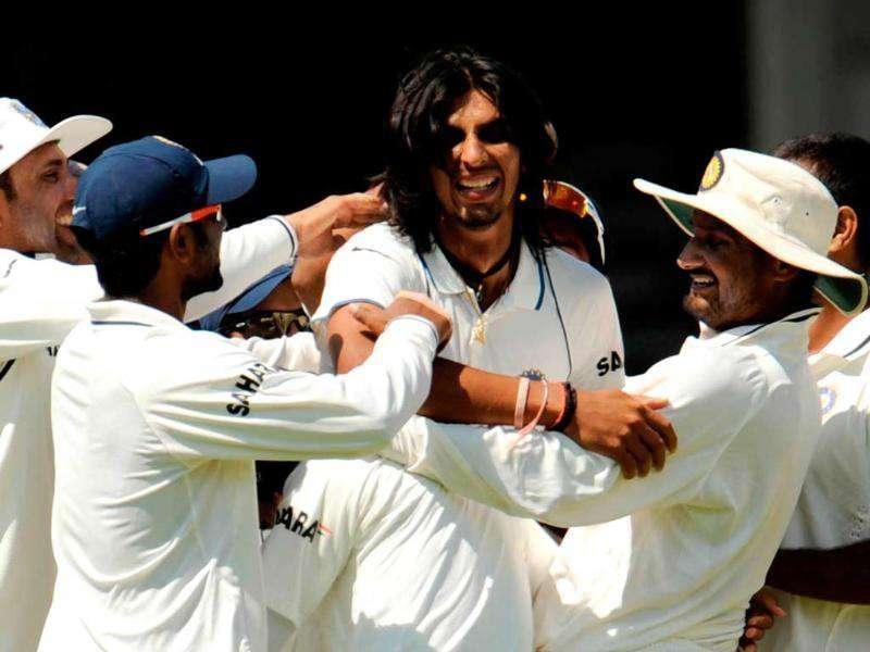 Ishant Sharma (C) is congratulated after the dismissal of England's Ian Bell during the first cricket Test match at Lord's in London.