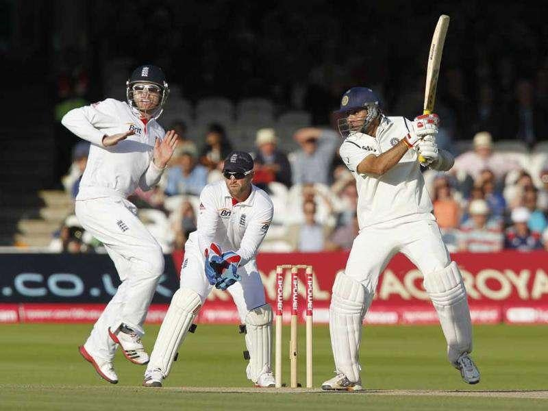 VVS Laxman (R) plays a shot as England's wicketkeeper Matt Prior (C) watches and Ian Bell (L) reacts during Day 4 of the first Test match at Lord's in London.