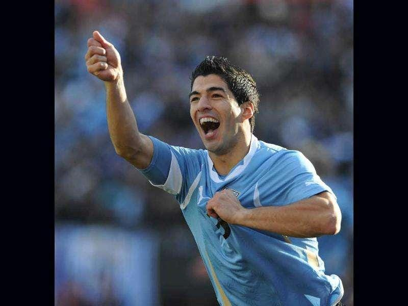 Uruguayan forward Luis Suarez celebrates after scoring the first goal of the final of the 2011 Copa America football tournament held at the Monumental stadium in Buenos Aires.