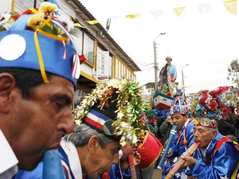 Chileans in traditional costumes take part during the annual celebration and pilgrimage of San Pedro in Horcon city.