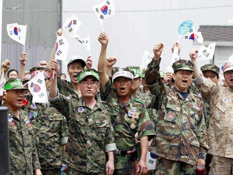 South Korean Vietnam War veterans shout slogans during a rally opposing the scheduled visit of Japanese lawmakers, in front of the Japanese embassy in Seoul, South Korea. Four Japanese lawmakers from the opposition Liberal Democratic Party announced earlier this month that they will visit Ulleung Island, located in northwest of Dokdo islets which are claimed by South Korea and Japan, for inspection.