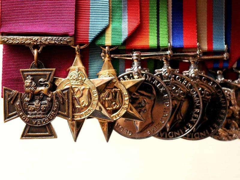 The Victoria Cross (VC) medal (L) awarded to Ted Kenna for bravery during action against the Japanese in New Guinea, is up for auction in Melbourne. One of 20 Victoria Crosses awarded to Australians during the Second World War, the medal is expected to fetch around $974,000 when auctioned on July 28.