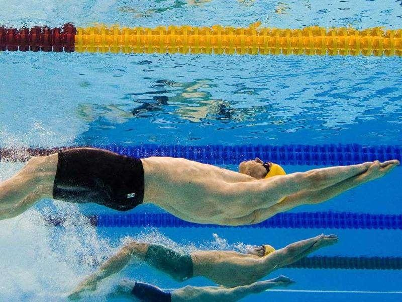 In a picture taken with an underwater camera Germany's Helge Meeuw (front) and Australia's Ben Treffers (C) compete in the heats of the men's 100-metre backstroke swimming event in the FINA World Championships at the indoor stadium of the Oriental Sports Center in Shanghai.