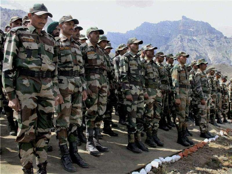 Army personnel paying tributes to the Martyrs of Kargil War in front 'Tiger Hill' which was re-Captured by Army, during celebrations of 'Operation Vijay Diwas-2011'.