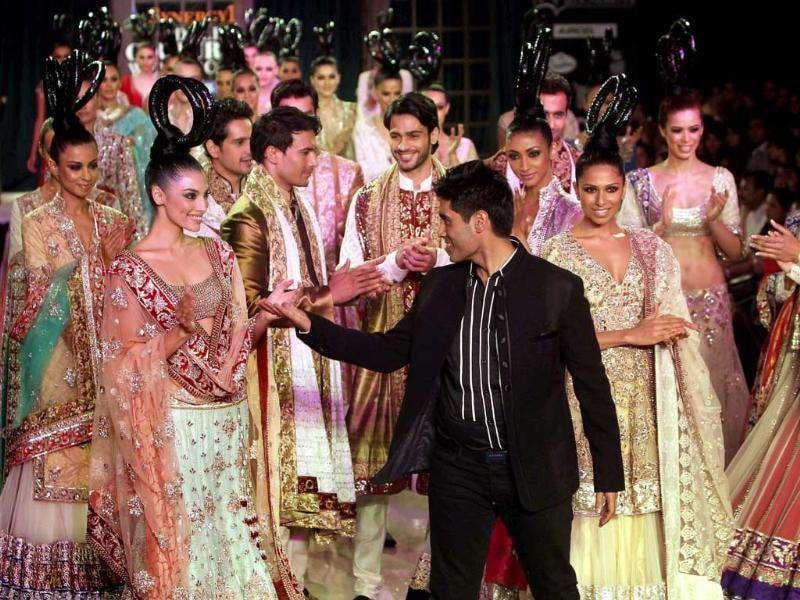 Models display creation of designers Manish Malhotra during the Synergy1 Delhi Couture Week 2011 in New Delhi on Sunday.