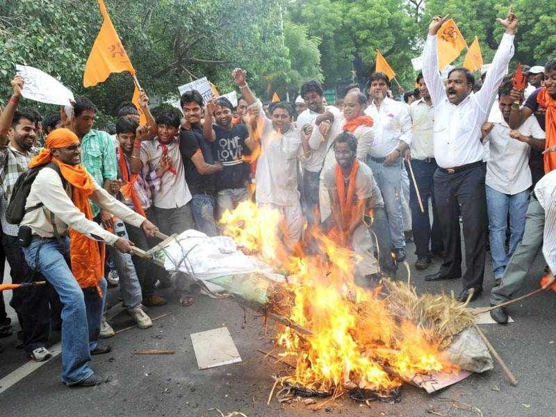 Hindu Struggle Committee activists burn an effigy while shouting slogans against the UPA government during a protest against the 'Prevention of Communal and Targeted Violence Riots' Bill terming it as anti-Hindu.