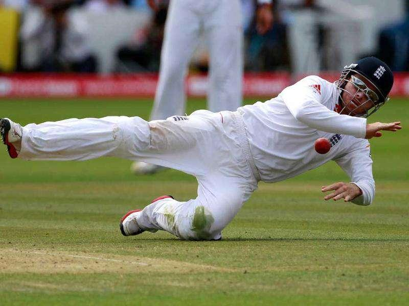 England's Ian Bell dives to stop a ball during the final day of the first cricket Test match against India at Lord's in London.