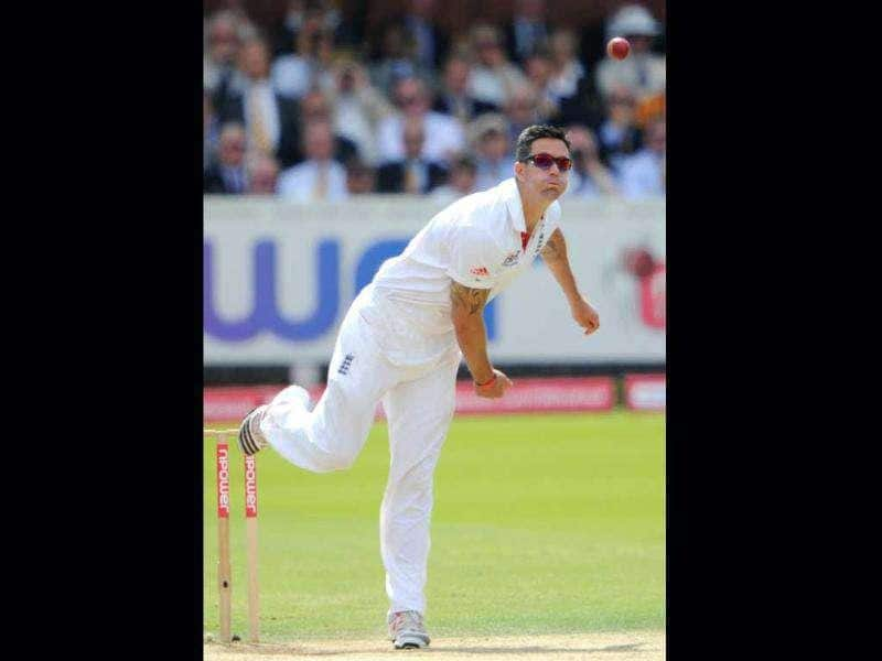 England's Kevin Pietersen bowls a ball to Mahendra Singh Dhoni during the fifth day of the first Test match at Lord's in London.