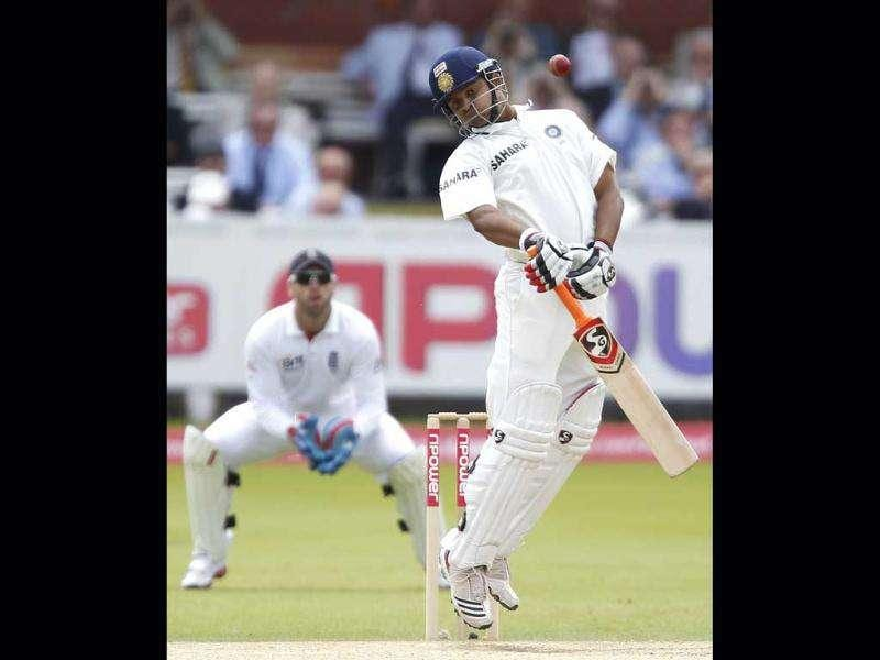 Suresh Raina (R) avoids a ball bowled by England's James Anderson during the fifth day of the first Test match at Lord's in London.