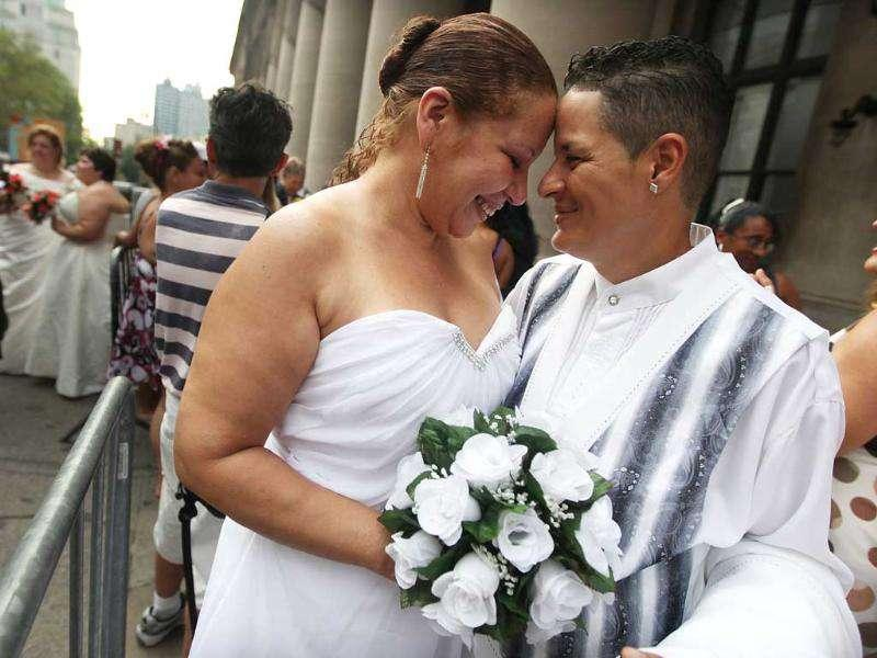 Maira Garcia (R) and Maria Vargas wait in line to get married at the Brooklyn City Clerk's office in New York City.