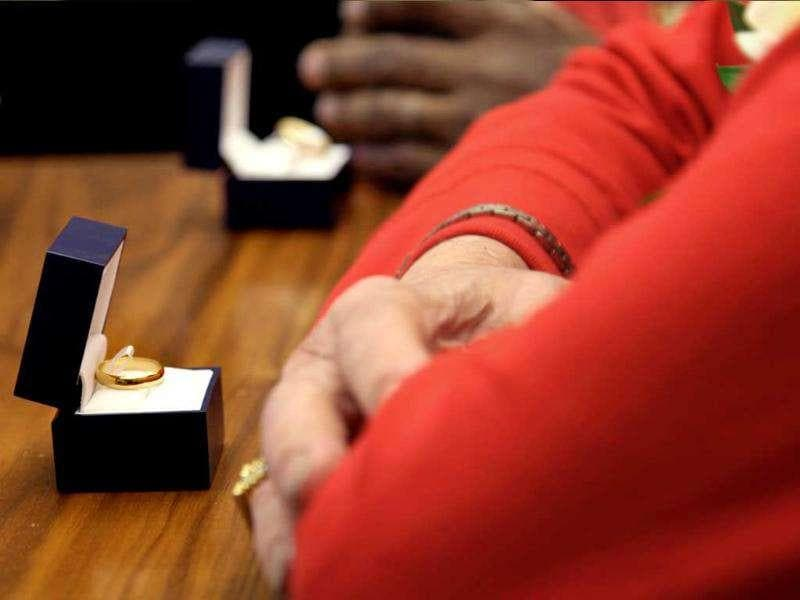 The rings of Michael Johnson (55) and Michael Roberts (81) are ready during their marriage ceremony at the City Clerk's office in New York.