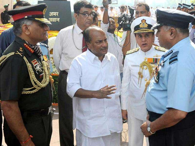 Defence minister AK Antony gestures while talking with Indian Air Force (IAF) Chief Air Chief Marshal Pradeep Vasant Naik as Indian Army Chief General VK Singh (L) and Vice Chief of Navy DK Deewan (2R) looks during a tribute ceremony to commemorate twelve years since the victory of the Kargil war in New Delhi.