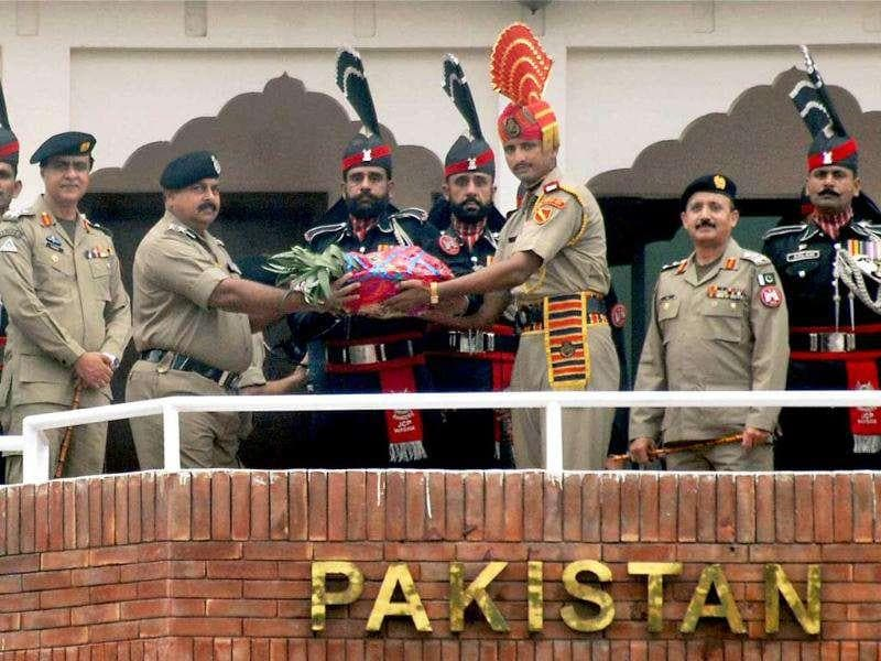 C Vasudevan, BSF Deputy Inspector General, leading a ten-member delagation, gives sweets basket to Pakistani rangers at the Pakistan side of India-Pakistan International Attari-Wagah border near Amritsar.