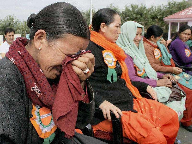 Relatives of Kargil war martyrs break down during a function on the occasion of 'Vijay Diwas' in Drass, Jammu and Kashmir.