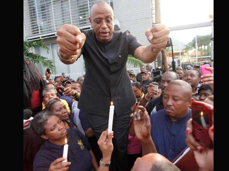 Oilfield Workers Trade Union President Ancel Roget speaks with union members after a meeting between union leaders and Trinidad and Tobago's Prime Minister Kamla Persad-Bissessar over a wage dispute outside the prime minister's office in St Clair.