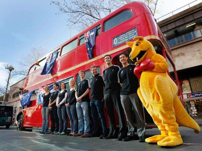 Australian 2012 Olympic team hopefuls pose with a boxing kangaroo in front of a London bus at a media event in Sydney. The event signalled the one year to go countdown to the London Olympics.
