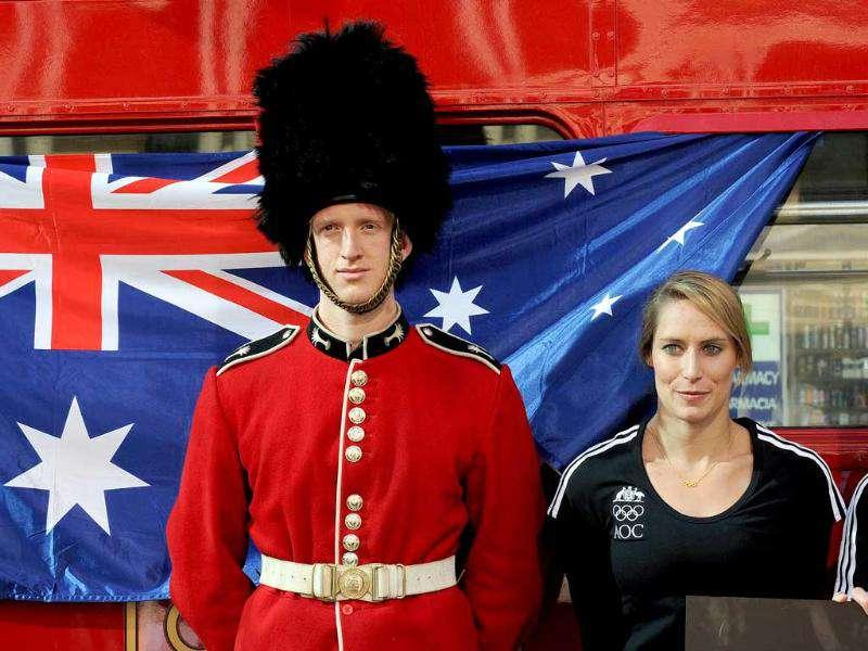 Australian Olympian Alex Croak (R), stands alongside Joshua King dressed as a ceremonial Beefeater, during One-Year-To-Go milestone celebrations for the 2012 London Olympics, in Sydney.