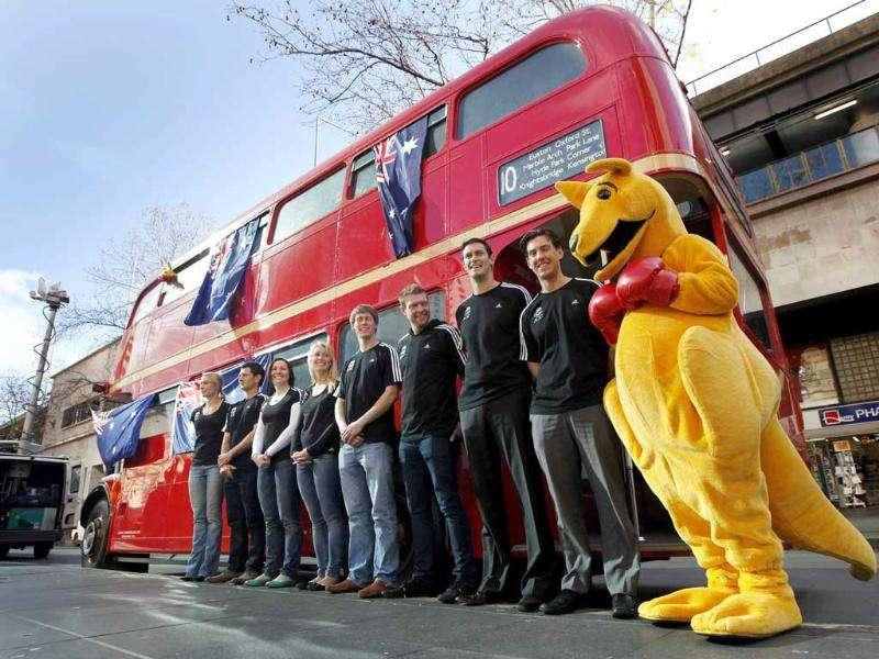 Australian 2012 Olympic team hopefuls pose with a boxing kangaroo in front of a London bus at a media event in Sydney.