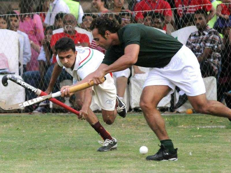 World hockey's leading goal-scorer Sohail Abbas (R) of Pakistan plays hockey during a ceremony to mark the 365-day countdown to London Olympics 2012 in Karachi.