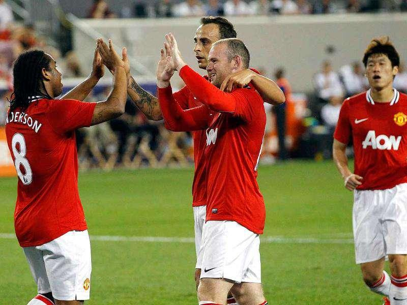 Manchester United's Anderson (L) is congratulated by teammmates Wayne Rooney (front C), Dimitar Berbatov (rear C) and Park Ji-sung (R) after Anderson scored against the Major League Soccer All-Stars during their match at Red Bull Arena in Harrison, New Jersey.