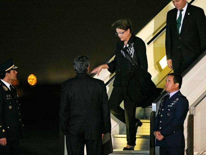 Brazil's President Dilma Rousseff descends from her airplane upon arrival at the airport in Lima.