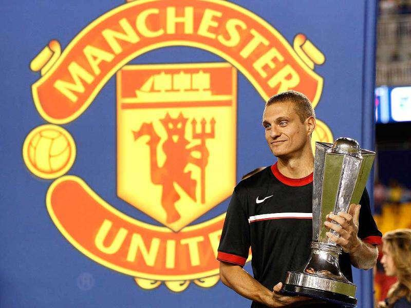 Manchester United's Nemanja Vidic celebrates with the trophy after defeating the MLS All-Stars 4-0 during the MLS All-Star Game at Red Bull Arena in Harrison, New Jersey.
