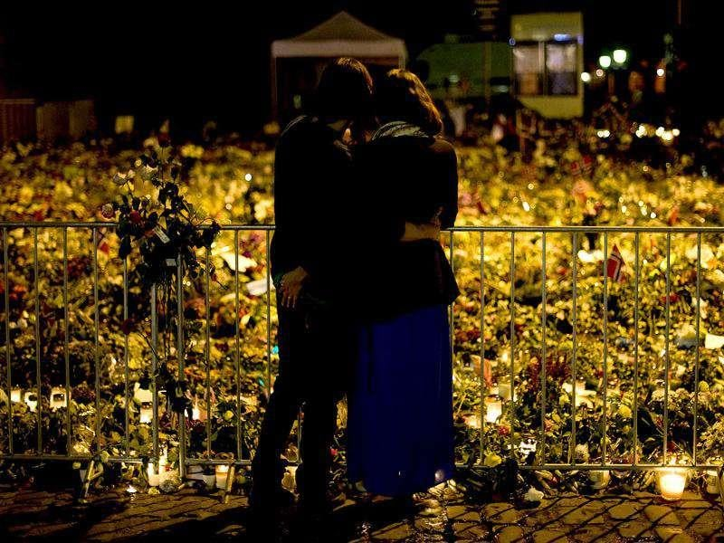 People visit a memorial outside the Cathedral in Oslo in honour of the victims of the July 22 attacks.