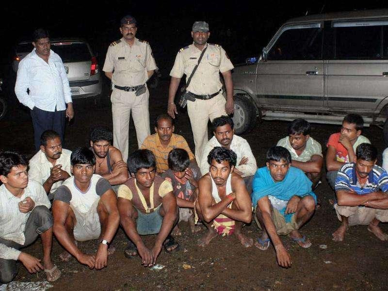 Members of a racket involved in unlawful sand dredging after their arrest by the police in Thane, Mumbai.