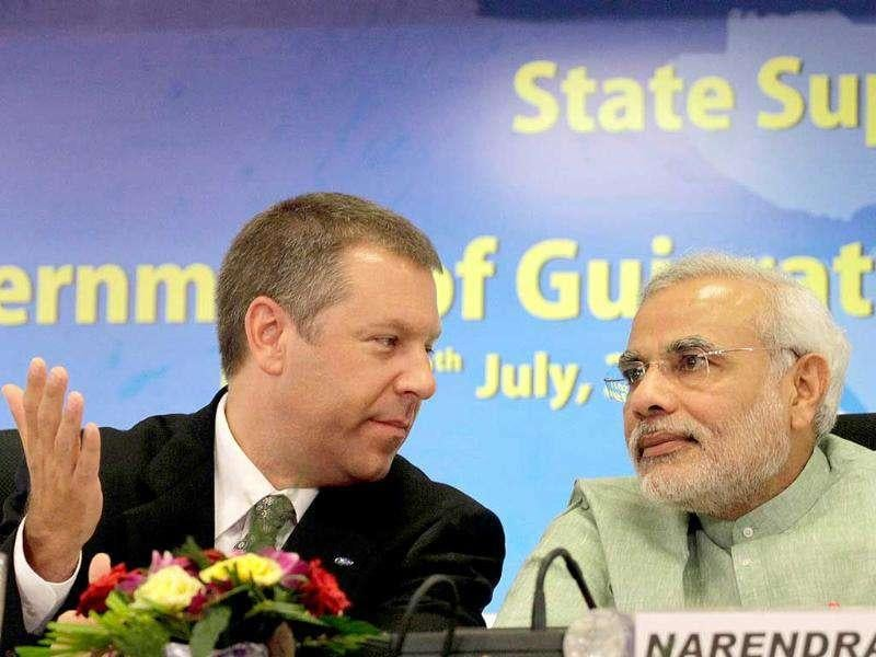 Ford Asia Pacific and Africa president Joe Hinrichs talks to Gujarat state chief minister Narendra Modi after signing a state support agreement between Government of Gujarat and Ford India Private Limited at Gandhinagar.