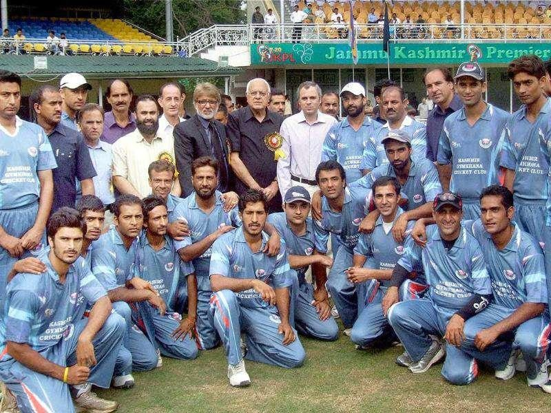 J&K chief minister Omar Abdullah and Union minister Farooq Abdulla pose for a photo with the players during the final match of JKPL - T20 tournament in Srinagar.