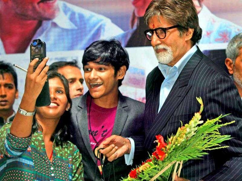 Amitabh Bachchan interacts with his fans.