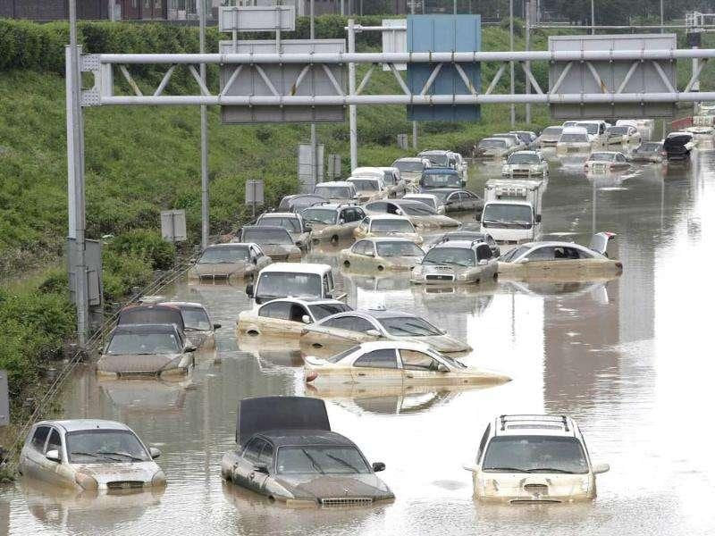 Vehicles are submerged in floodwater after heavy rain in Seoul, South Korea.