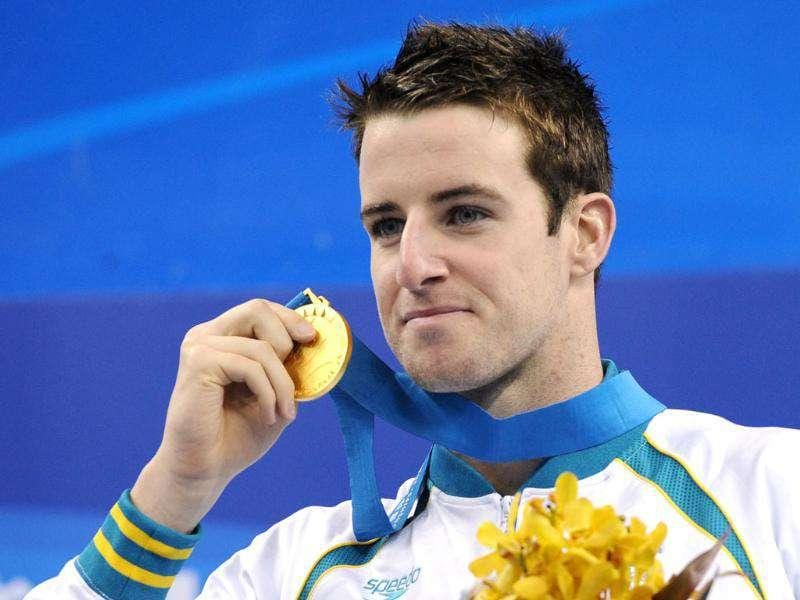 (FILES) Australia's James Magnussen holds his gold medal on the podium during the award ceremony for the final of the men's 100-metre freestyle swimming event in the FINA World Championships at the indoor stadium of the Oriental Sports Center in Shanghai.