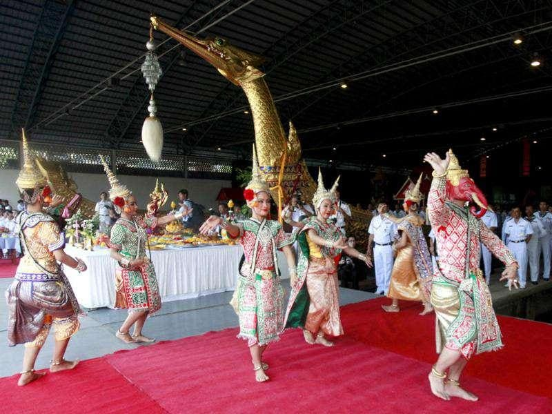 Traditional Thai performers dance during a worship ceremony which is a sacred ritual for the Royal Barge Procession at the Royal Barges National Museum in Bangkok.