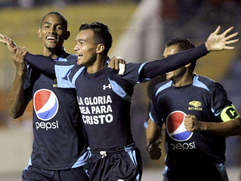 CD Motagua's Odis Borjas (C) celebrates his goal with Jerry Bengtson (L) and Amado Guevara during their CONCACAF Champions League soccer match against CSD Municipal in Tegucigalpa.