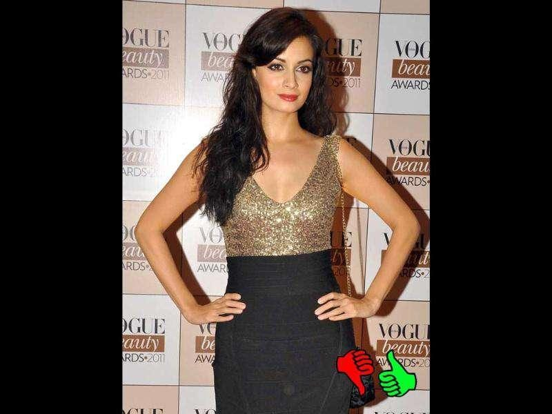 Diya Mirza has the body to rock the gold and black number she donned, but why so much pancake Diya?