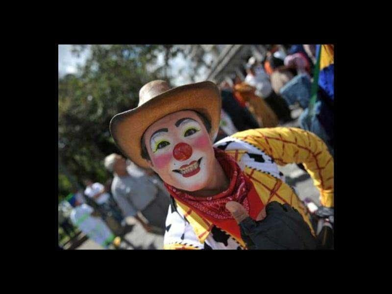 A clown poses for the camera during a parade in the historic centre of Guatemala City in the framework of the III Latin American Clown Congress.