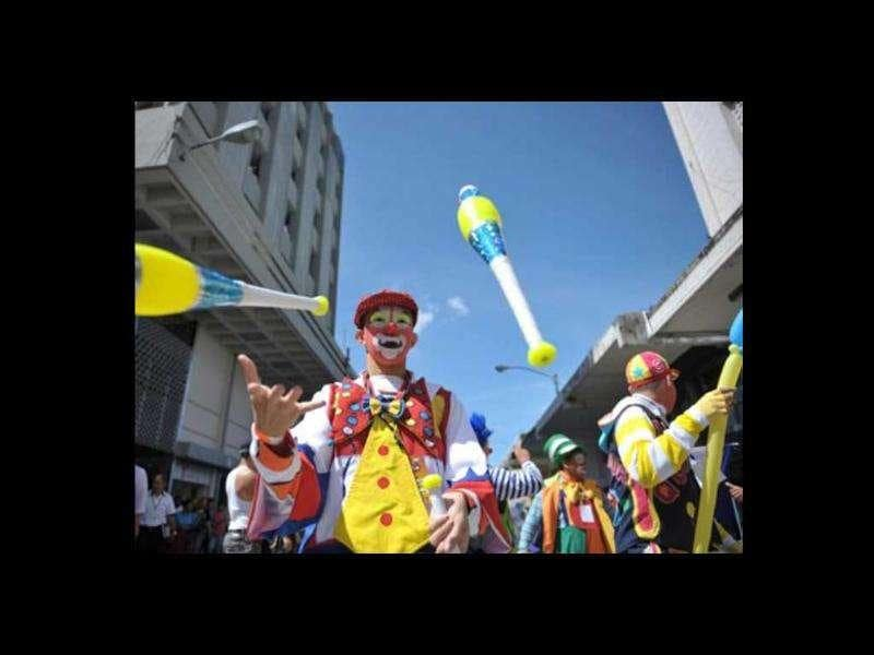 Clowns take part in a parade in the historic centre of Guatemala City in the framework of the III Latin American Clown Congress.