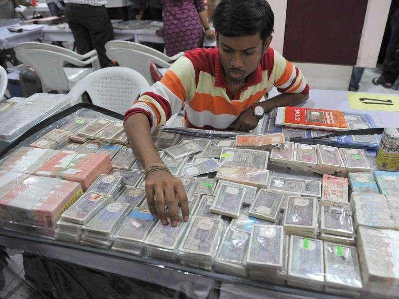 A collector displays Indian currency at a three day Coins & Notes fair in Hyderabad.