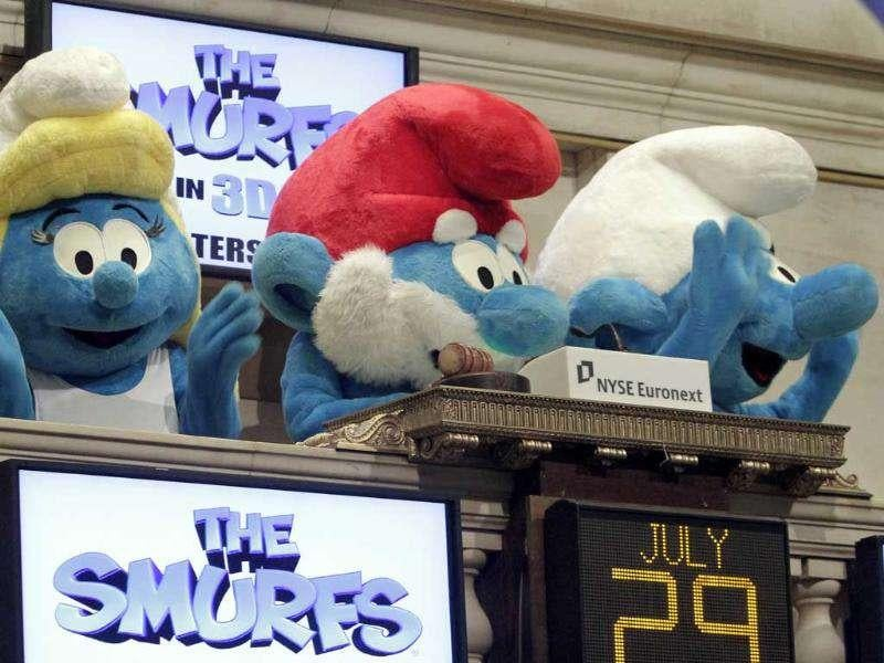 Smurfette, Papa Smurf, and Clumsy Smurf, left to right, ring the opening bell of the New York Stock Exchange.