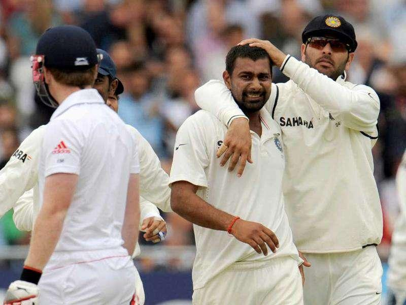 India's Praveen Kumar is congratulated by teammate Yuvraj Singh (R) after the dismissal of England's Eoin Morgan during the second cricket Test match at Trent Bridge in Nottingham.